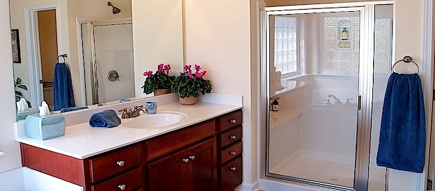 your gleaming blue bathroom on cleaning day